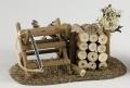 Sägebock mit Holzstoß